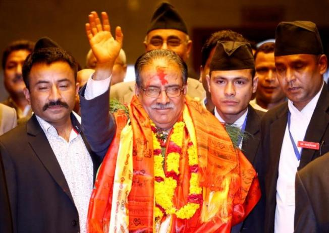 FILE PHOTO: Nepal's newly elected Prime Minister Pushpa Kamal Dahal, also known as Prachanda, waves towards the media after he was elected Nepal's 24th prime minister in 26 years, in Kathmandu